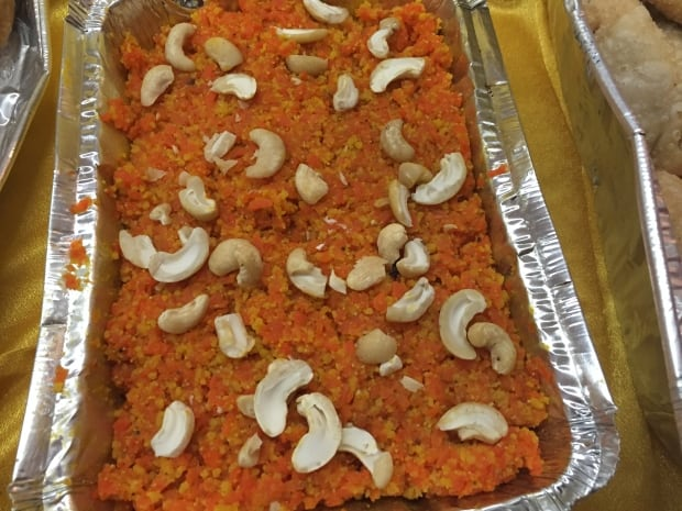 Halwa is a sweet dessert pudding made with grated carrot in a pot of ...