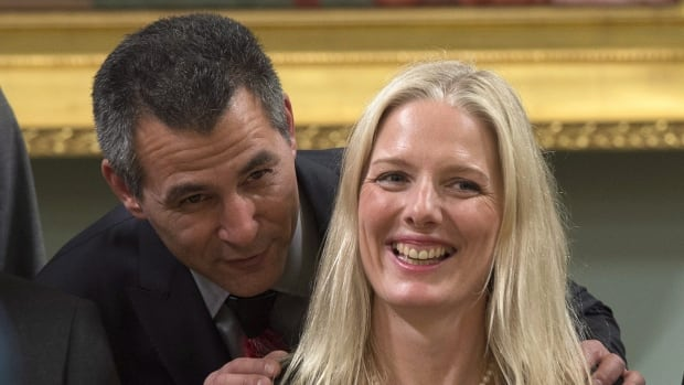 Hunter Tootoo, minister of fisheries, oceans, and the Canadian Coast Guard speaks with Catherine McKenna, minister of the environment and climate change after being sworn in. McKenna says the national target set by the Conservatives for cutting greenhouse gas emissions should be considered a floor for future action.