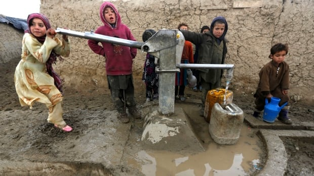 Internally displaced Afghans collect water from a public water pump next to their tents at a refugee camp in Kabul in January. Billions of people around the world rely on groundwater for drinking, washing and farming.