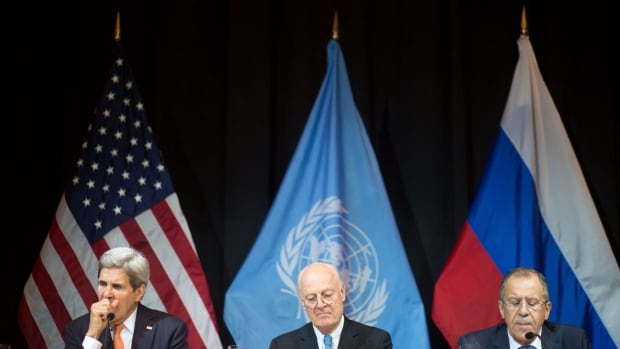 US Secretary of State John Kerry, left, United Nations Special Envoy for Syria Staffan de Mistura, centre, and Russia's Foreign Minister Sergei Lavrov address the media after a meeting in Vienna, Austria, on November 14, 2015.