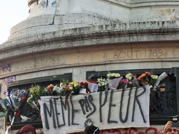 Paris attacks vigil banner