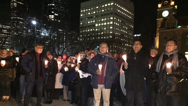 Dozens of Calgarians attended a rally at city hall organized by the Muslim Council of Calgary to honour the victims of the Paris attacks and condemn terrorism.