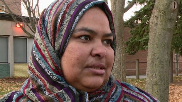 Inass el-Hassen spoke to reporters near the Toronto school where a Muslim mom was attacked on Monday night. El-Hassen called the violence 'unacceptable.'