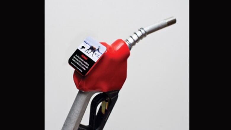 Climate change sticker on gas pump