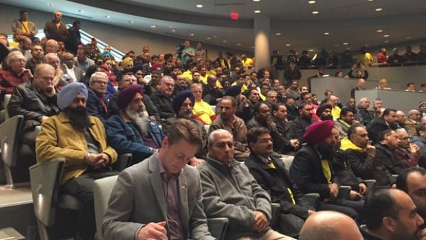 Hundreds of taxi drivers and industry members packed city hall for the latest debate about legalizing Uber.