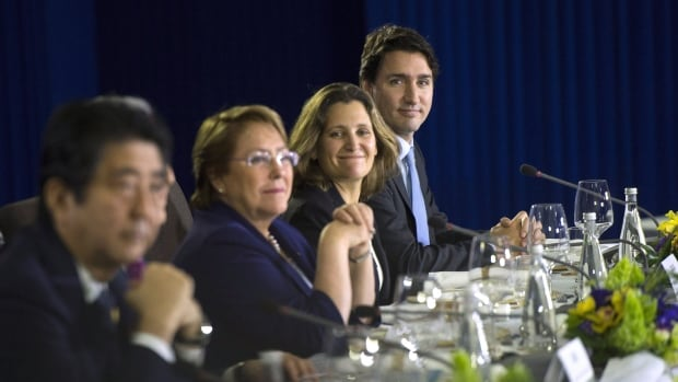 Prime Minister Justin Trudeau, right, sits beside Minister of International Trade Chrystia Freeland as they take part in the APEC Summit in Manila on Wednesday.