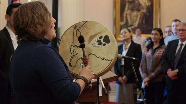 A Métis woman performs at the proclamation of the Restorative Justice Act at the Manitoba legislative building on Wednesday.
