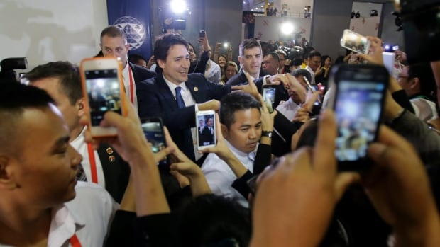 Canadian Prime Minister Justin Trudeau is surrounded by admirers as he leaves the International Media Centre following a press conference at the close of the recent Asia-Pacific Economic Co-operation summit in Manila, Philippines.