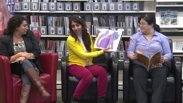 Readers from several countries were on hand Thursday to show off new multi-lingual picture books at St. John's libraries.