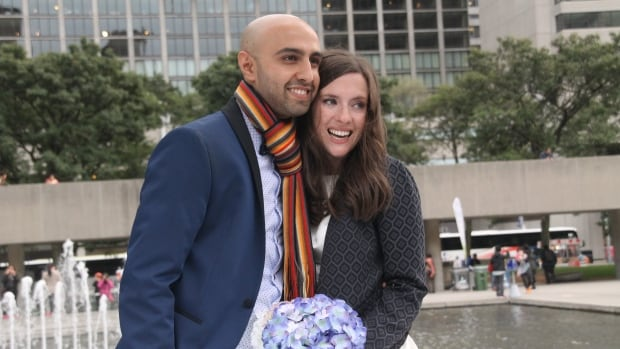 Samantha Jackson and Farzin Yousefian cancelled expensive wedding plans and had a small Toronto city hall ceremony instead, to help get together the money to sponsor a Syrian refugee family of four.