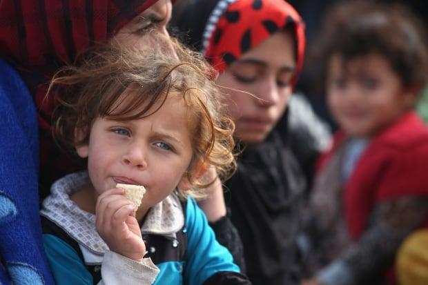 Sinjar town retaken from ISIS Yazidi families flee Nov 16 2015