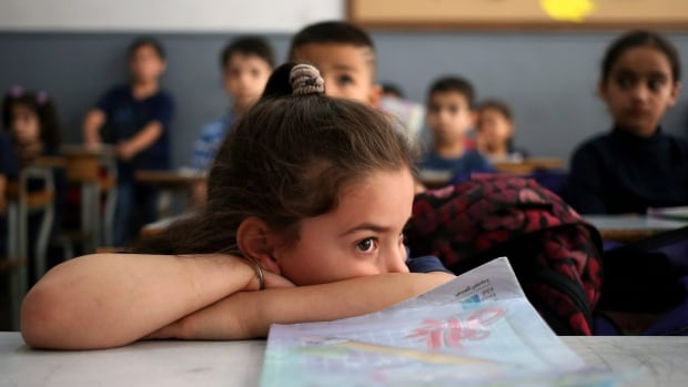 A Syrian refugee student waits in her classroom at a Lebanese public school in Beirut in June 2014.