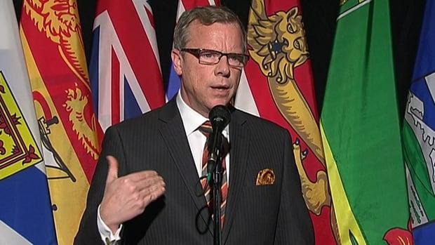 Saskatchewan Premier Brad Wall speaks to reporters in Ottawa on Monday.