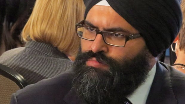 Tory MLA Manmeet Bhullar was killed in a highway accident Monday while trying to help another motorist.