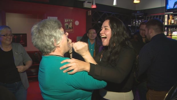 Newly elected Yellowknife Centre MLA Julie Green, left, celebrates her victory Monday night with Nigit'Stil Norbert, who lost to Bob McLeod on election night.