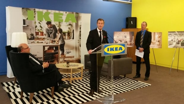 Kitchener mayor Berry Vrbanovic, seated, Ikea Canada president Stefan Sjostrand, and Rod Regier, Kitchener's head of economic development, announce a new Ikea pick-up and order point, on Tuesday.