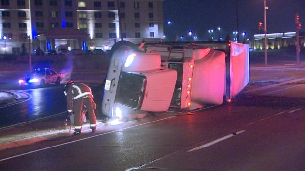 Three men were arrested after allegedly stealing this tractor trailer, which was full of cheese, before crashing on a highway off-ramp north of Toronto.