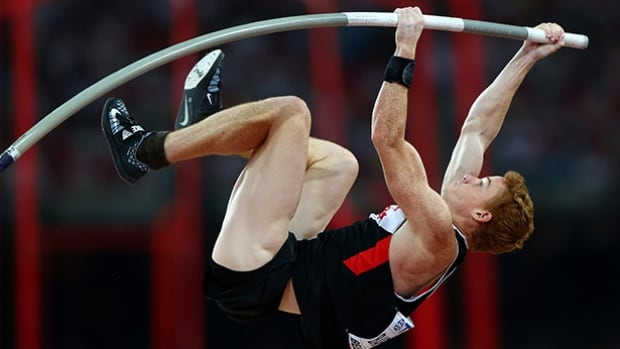 Shawn Barber made Canadian history by winning gold in the men's pole vault at this year's track and field world championships in Beijing. His father, George Barber, has been banned from coaching by Athletics Canada.