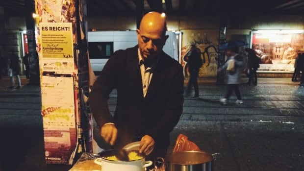 Alex Assali has been serving up dishes to the city's needy since August, building a stand in different spots around Berlin once a week.