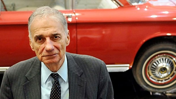 Consumer advocate Ralph Nader poses in front of a Chevrolet Corvair in The American Museum of Tort Law in September. He is now turning his guns on low interest rates.