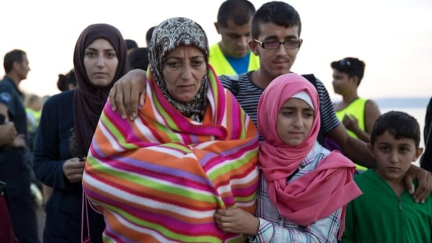 Syrian refugees arrive in Greece.
