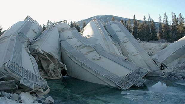 Train cars stacked up after derailing on a bridge over a creekbed in Banff National Park on Dec. 26, 2014.