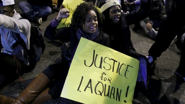 Protesters demonstrate in response to the fatal shooting of Laquan McDonald in Chicago. Newly released documents show  police reports about the shooting contrast sharply with what was captured on the dashcam footage.