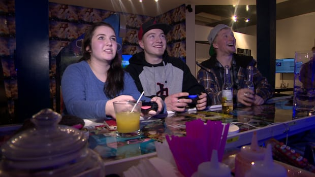 Patrons at the Bartari video game bar in Saskatoon