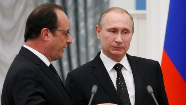 Russian President Vladimir Putin, right, and his French counterpart Francois Hollande leave after a news conference after their meeting in Moscow on Thursday.