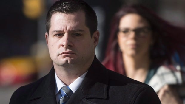 Const. James Forcillo, charged in the shooting death of Sammy Yatim, walks into court in Toronto, Wednesday, Nov, 25, 2015. On Monday, a jury found Forcillo guilty of attempted murder but not guilty of second-degree murder.