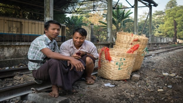 Basket salesmen in Rangoon, Burma.