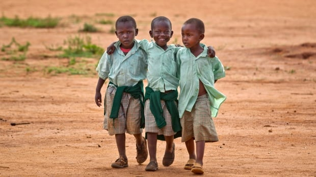 Millions of children in sub-Saharan Africa are HIV positive or are orphaned by AIDS. Few are as fortunate as these boys walking home from the Hot Courses Primary School  in Kenya.