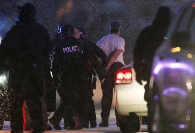 Colorado Springs gunman in handcuffs
