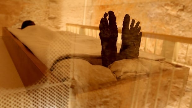 The linen-wrapped mummy of King Tutankhamun is seen in the Valley of the Kings in Luxor, Egypt.