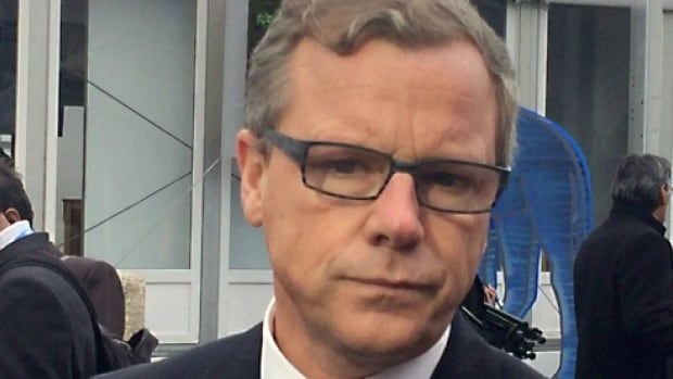 Brad Wall speaks to reporters at the UN climate conference in Paris on Monday.