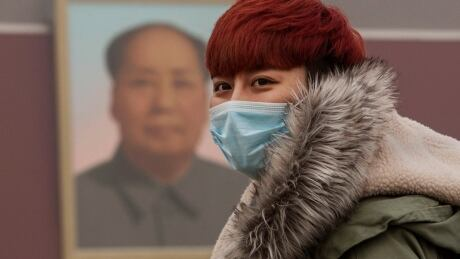 Beijing bad air quality Nov 30 2015 masked red head Tianamen Gate