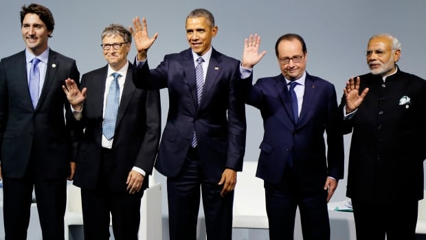 From the left, Prime Minister Justin Trudeau, Microsoft CEO Bill Gates, U.S. President Barack Obama, French President Francois Hollande and Indian Prime Minister Narendra Modi wave during the Mission Innovation: Accelerating the Clean Energy Revolution meeting at the United Nations Climate Change Conference.