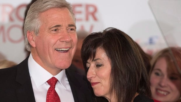 Dwight Ball, Newfoundland and Labrador's Liberal premier-designate, embraces his wife Sharon after winning a majority government in the provincial election in Corner Brook, N.L. on Monday.