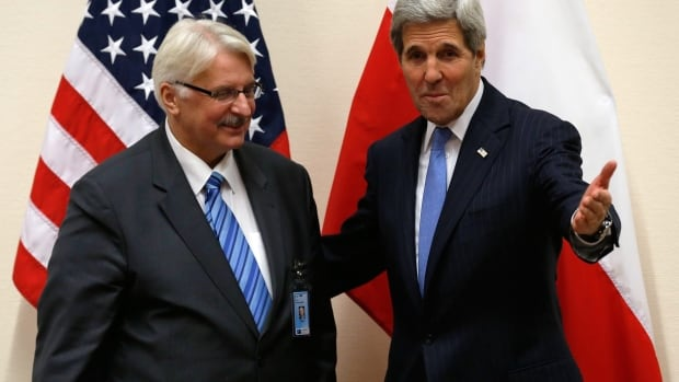 Polish Foreign Minister Witold Waszczykowski, left, meets with U.S. Secretary of State John Kerry at NATO Headquarters in Brussels on Tuesday.