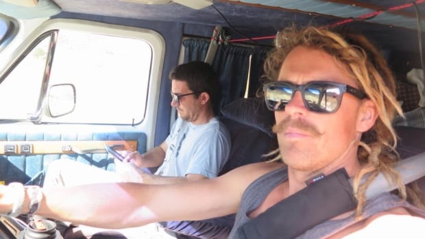 Adam Coleman (right) and Dean Lucas in the van which they drove from Edmonton to Mexico.