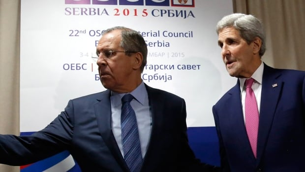 Russian Foreign Minister Sergei Lavrov, left, invites U.S. Secretary of State John Kerry to a sitting area as he arrives for their bilateral alongside the OSCE Ministerial Council meeting in Belgrade, Serbia, Thursday.