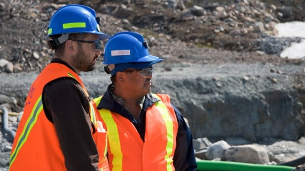 Surveyors with De Beers in the N.W.T. De Beers Canada says it's unsure of the future of the Snap Lake mine, given a downturn in diamond prices and a costly water problem that required a licence amendment.