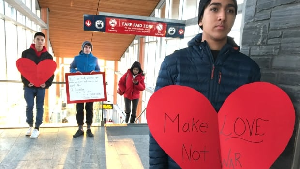 The group of young Calgarians brought large hearts and messages of peace and understanding to commuters hours after the Tuscany LRT station was vandalized with hateful graffiti against Muslims, Syrians, and refugees.