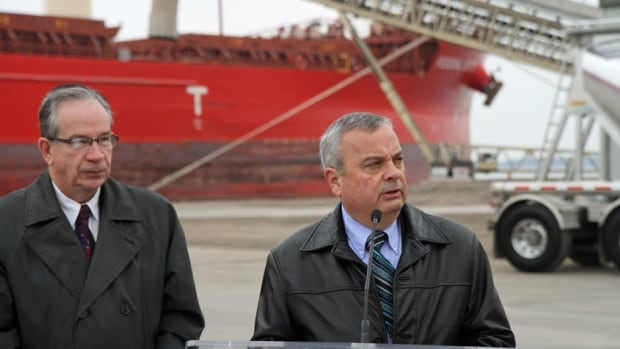 Derek Jamieson, president and COO of P&H Milling, announced his company is building a new flour mill on Hamilton's waterfront with the help of $5M from Minister of Agriculture Jeff Leal, left.