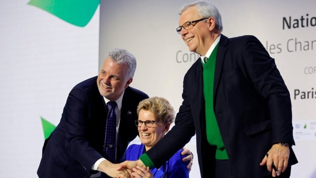 Quebec Premier Philippe Couillard, left, Ontario Premier Kathleen Wynne, center, and Manitoba Premier Greg Selinger shake hands during a signing ceremony at the COP21, the United Nations Climate Change Conference Monday, Dec. 7, 2015 in Le Bourget, north of Paris. The Paris conference is the 21st time world governments are meeting to seek a joint solution to climate change. The talks are focused on reducing emissions of carbon dioxide and other greenhouse gases, primarily by shifting from oil, coal and gas to cleaner sources of energy. (AP Photo/Christophe Ena)