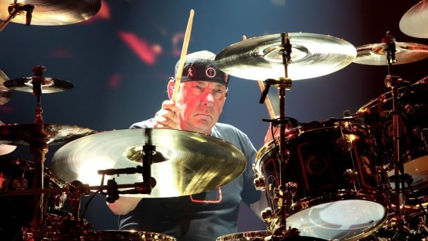 Rush drummer Neil Peart, seen in Philadelphia during the prog rock trio's R40 Live: 40th anniversary tour in June, has only retired from lengthy tours, according to bandmate Geddy Lee.