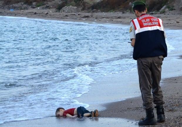 2015 photos of the year toddler Alan Kurdi body washed up Sept 2 Turkish beach