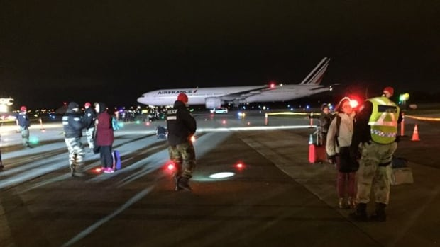 Police and firefighters were on the scene at Trudeau airport early Tuesday morning after the plane was diverted to Montreal.