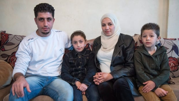 Syrian refugee Emad Alhajali, from Kherbet Ghazalah, Syria, sits with his daughter Fatma, 8, his wife Razan and son Mohammand. They were among the Syrians waiting for approval to immigrate to Canada.