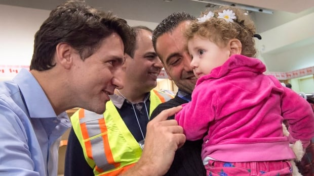 Canadian Prime Minister Justin Trudeau speaks with a young girl as he greets a family of Syrian refugees during their arrival at Pearson International airport in Toronto earlier this month.